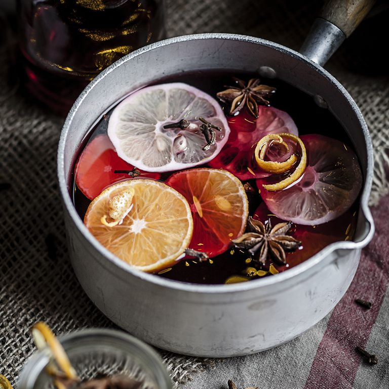 casserole with mulled wine slices of lemons and royalty free image 485246191 1541783264